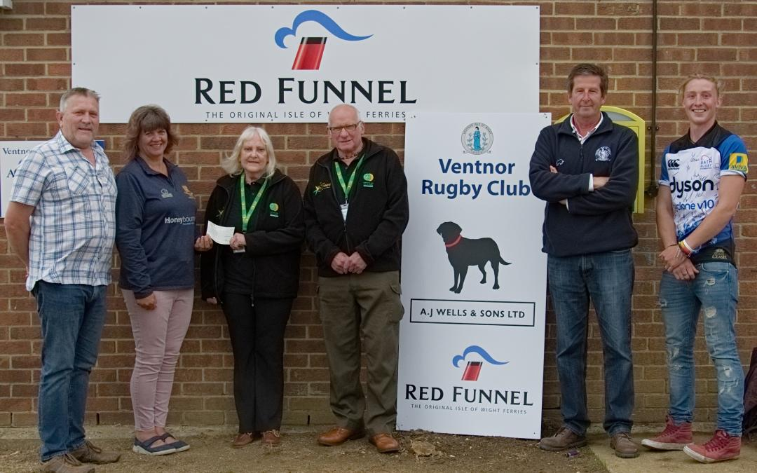 Ventnor RFC cheque presentation to Hampshire & IOW Air Ambulance 10/06/2019 following Isle of Wight RAndonnee 2019: L to R: Steve MACEY (VP), Kay ENGELGARDT (VP), Pat and Albie KNIGHT (Hampshire & IOW Air Ambulance, Roly TOOMBS (Clubhouse Manager), Chris HILL (player and Bar Manager): Photo credit: Ventnor RFC Magazine